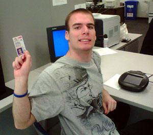 Mason holding State ID